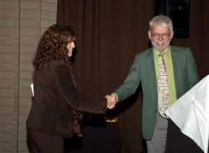 Past-President Dr. Gary Umphrey passing the Roach & Gavel to President Dr. Hannah Fraser